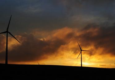 sunset wind night wind turbine total quadran